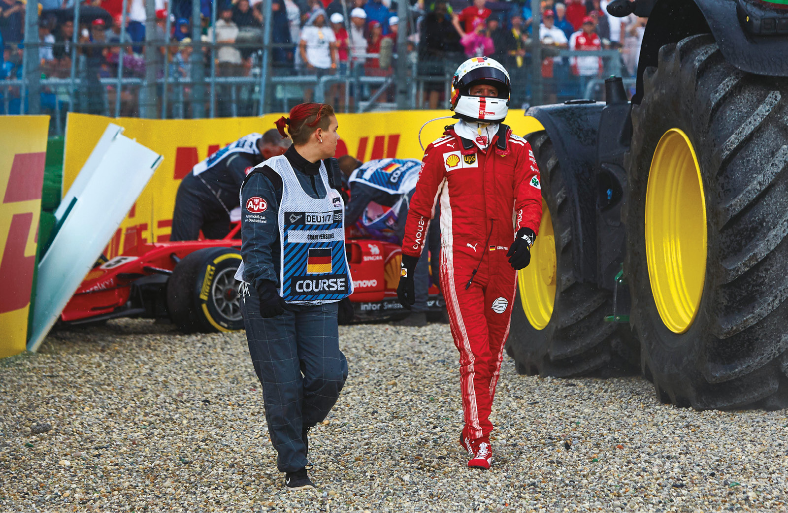 An emotional Vettel trudges away from his Ferrari after his costly error in Germany