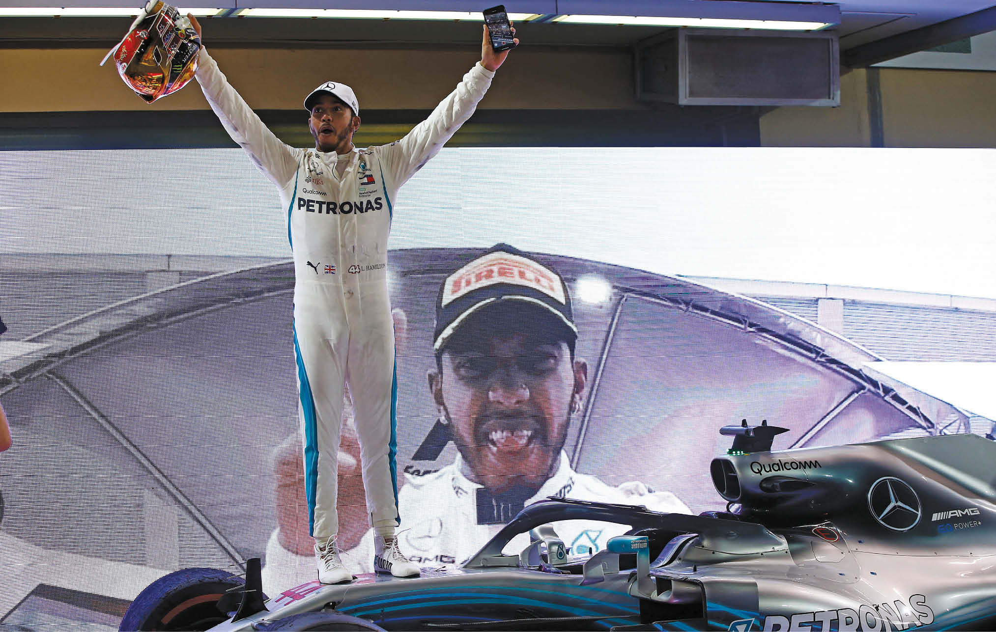 The many faces of Lewis. Hamilton celebrates his fifth world title at Abu Dhabi last year