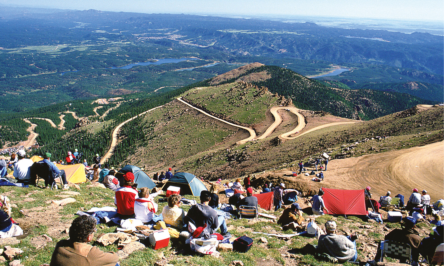 Who says Pikes Peak is all dust? Stunninly green landscape highlights the challenging track ascending.