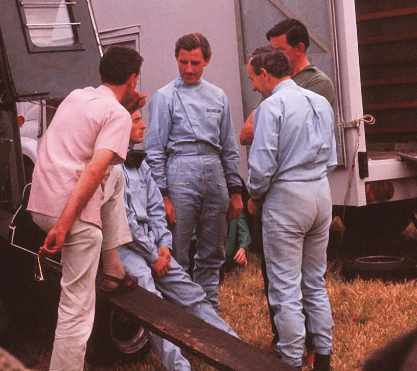 Driver access, and camaraderie, was very different back then. Here legends including Graham Hill and Jackie Stewart (Owen Racing Rover-BRM), John Surtees (Ferrari 330 P2) and team boss Rob Walker take time for a chat