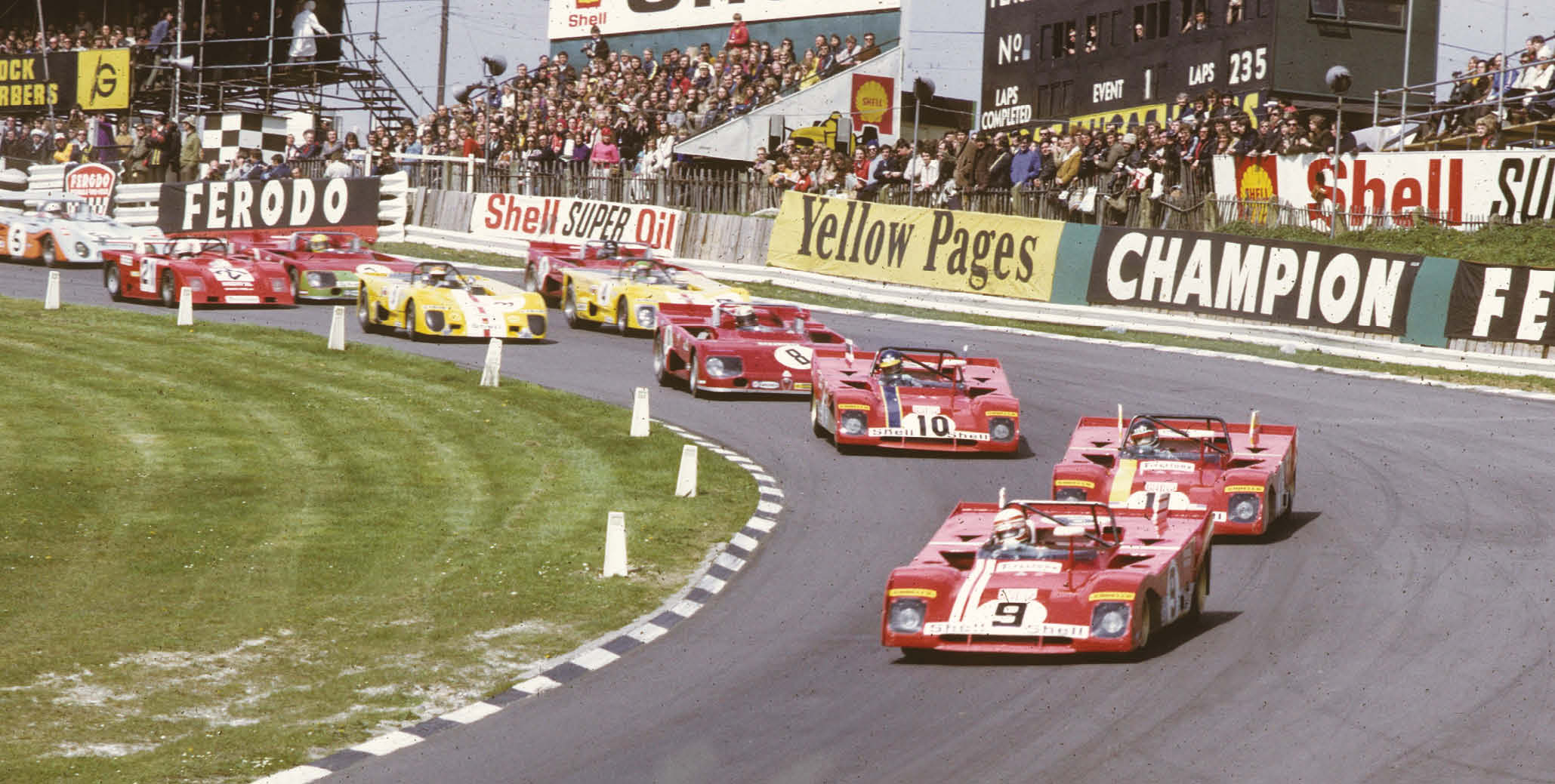 Clay Regazzoni leads the pack through Paddock Hill Bend in the Ferrari 312 PB he shared with Brian Redman. They would end up fifth overall after late engine trouble struck