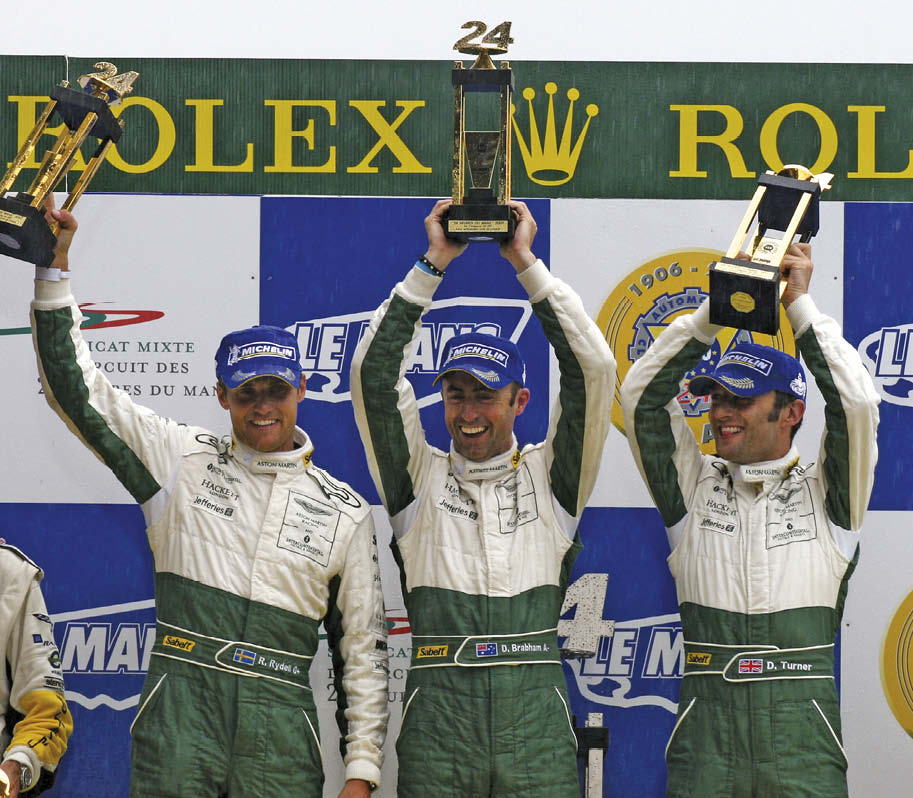 From left to right: Rydell, Brabham and Turner celebrate victory in 2007 after beating the elements and completing 343 laps of La Sarthe