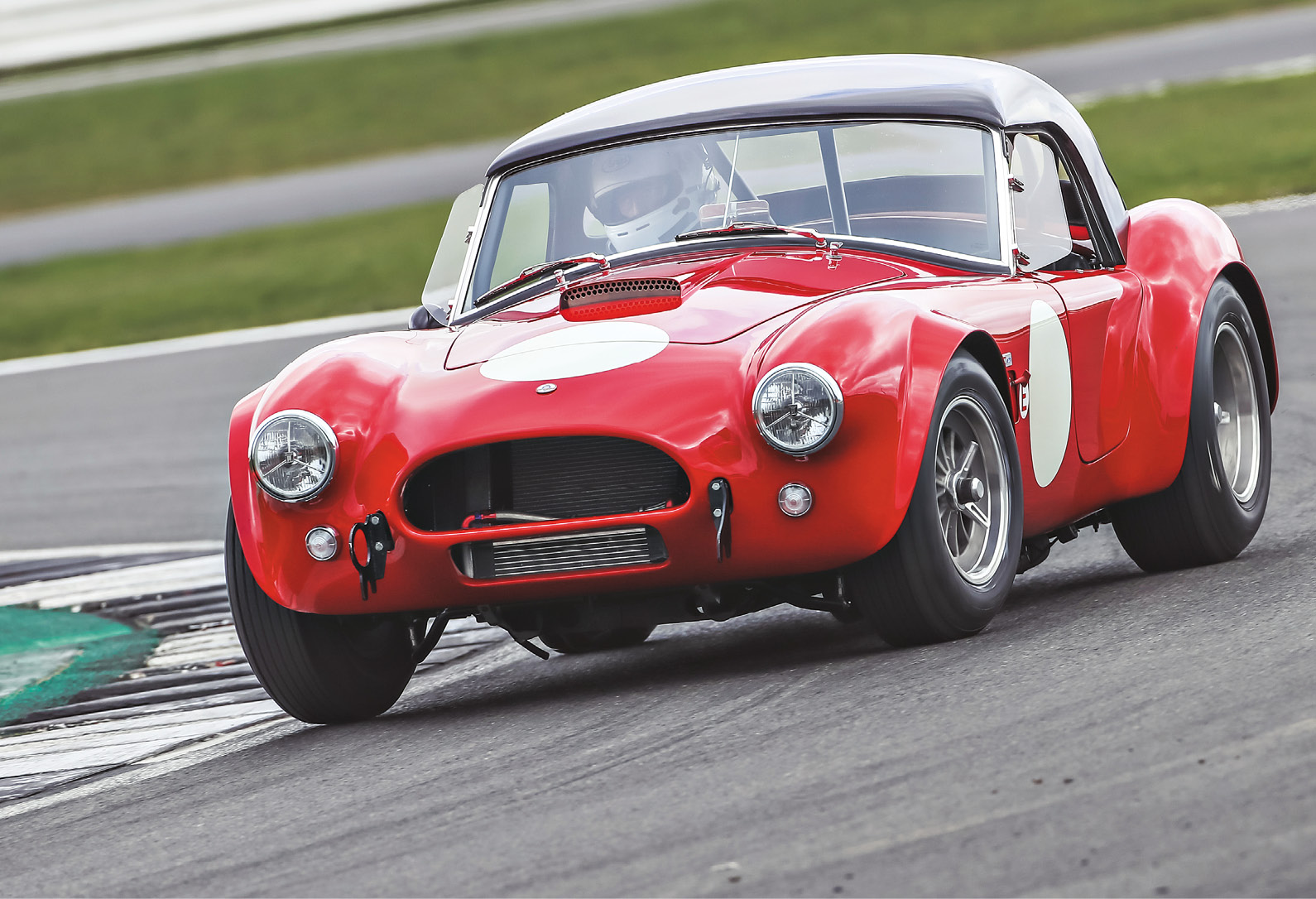 Legend says it's impossible to lift a wheel in an original Cobra due to the soft chassis