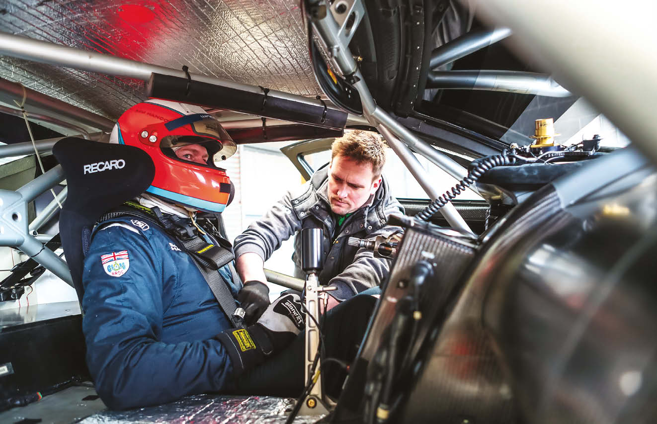 Hancock gets buckled in ahead of his shakedown with the car at Anglesey Circuit