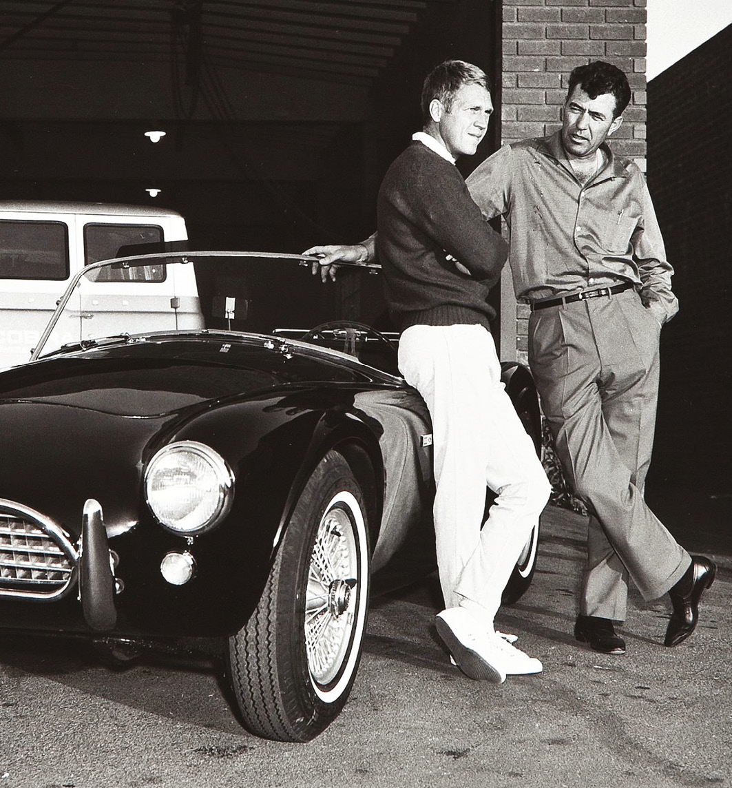 Pictured with Steve McQueen, Shelby, right, sought to beat Ferrari