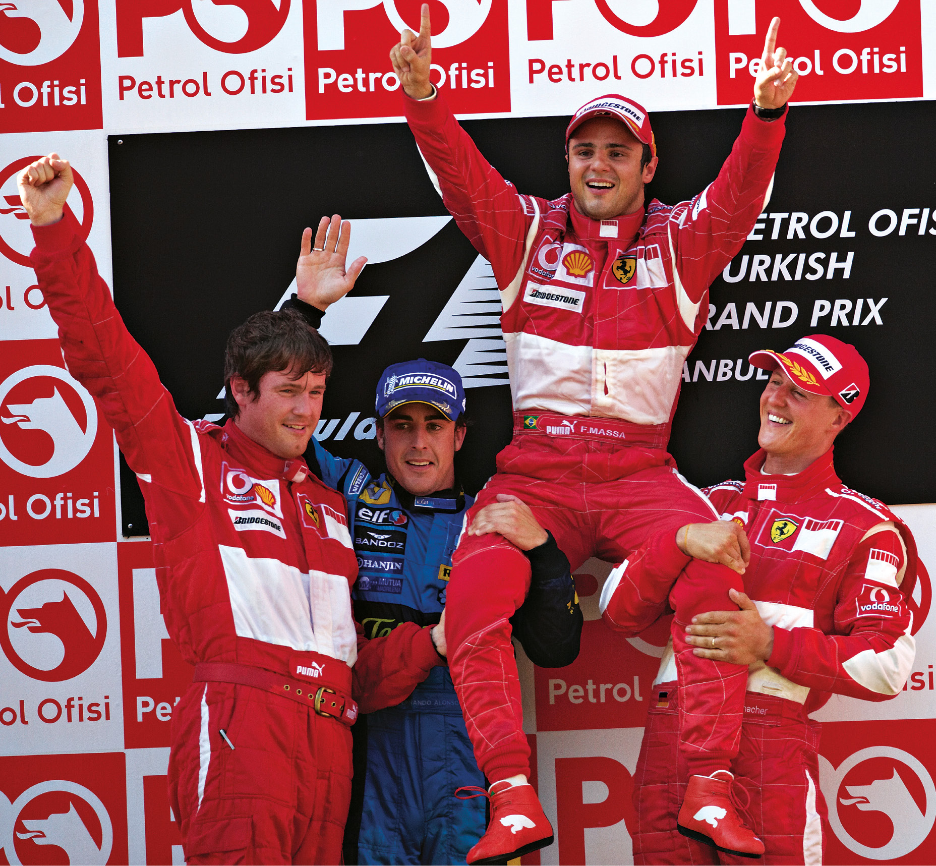 Smedley, left, with Alonso, winner Massa and Schumacher after the Brazilian's maiden F1 win in Istanbul