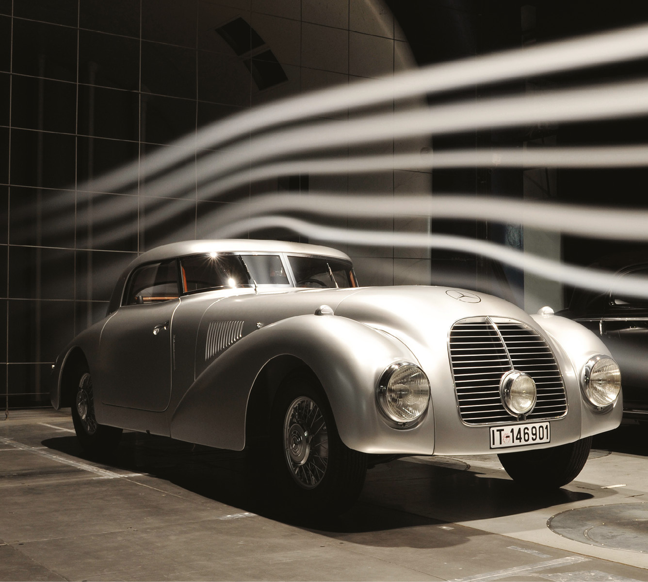 Air streamlines over a 1938 540K race coupé in Mercedes' current tunnel