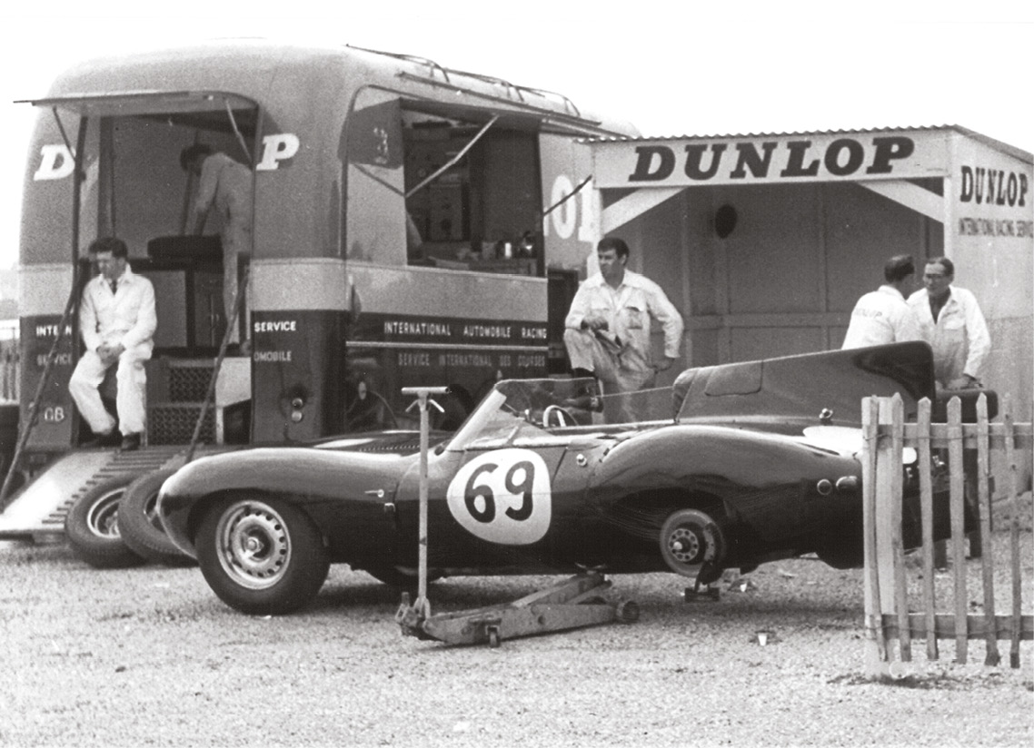 Proof that the Goodwood paddock wasn't quite as swish back then as it has since become... Mike Salmon's ex-Ecurie Ecosse D-type receives a fresh set of Dunlops, Easter 1961