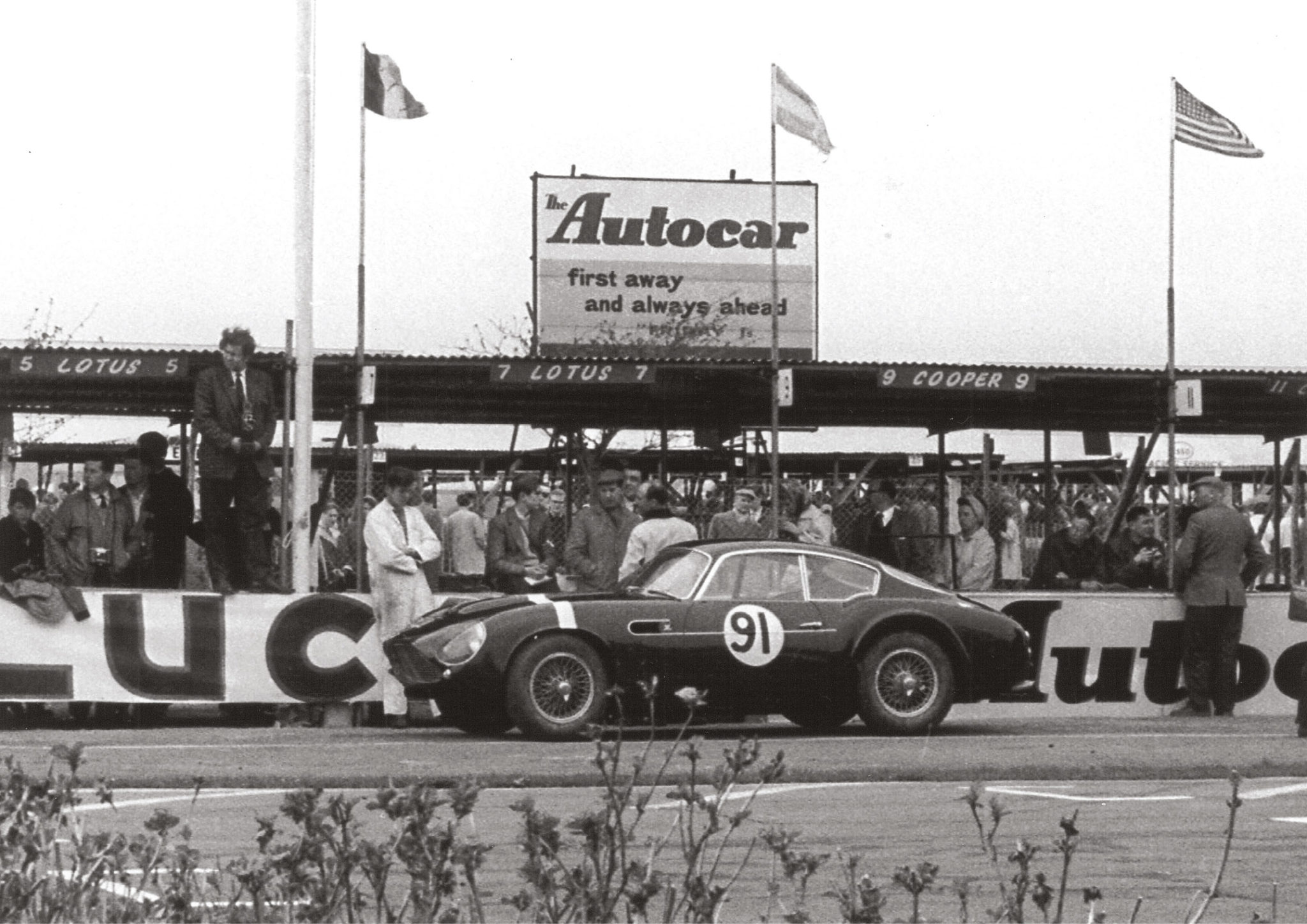 Stirling Moss's Aston Martin DB4 GT Zagato in the pits, Easter 1961. He finished third in the Fordwater Trophy, behind Mike Parkes and Innes Ireland