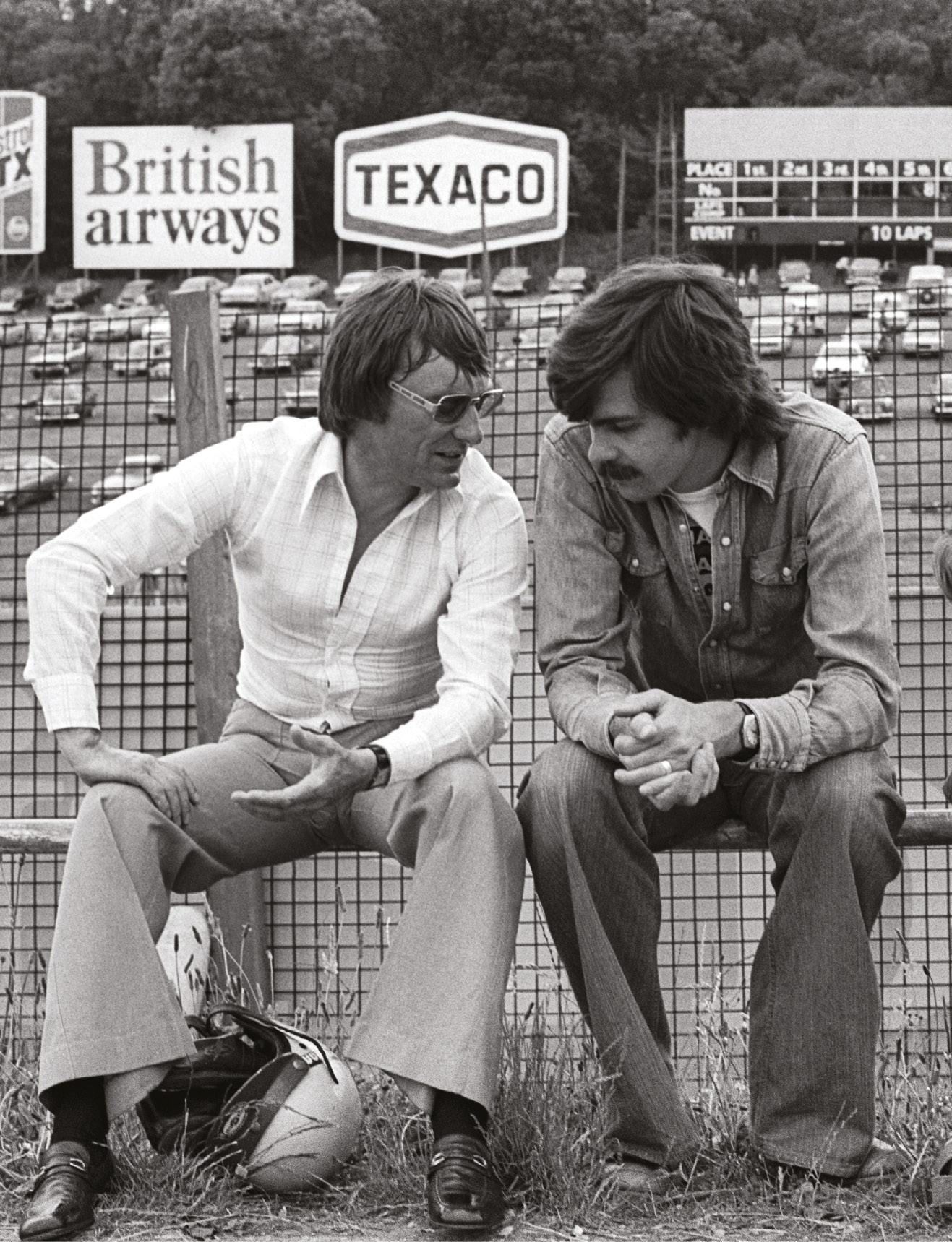 Gordon Murray chats with F1 tsar, and then Brabham team boss, Bernie Ecclestone during the 1975 British GP at Brands Hatch