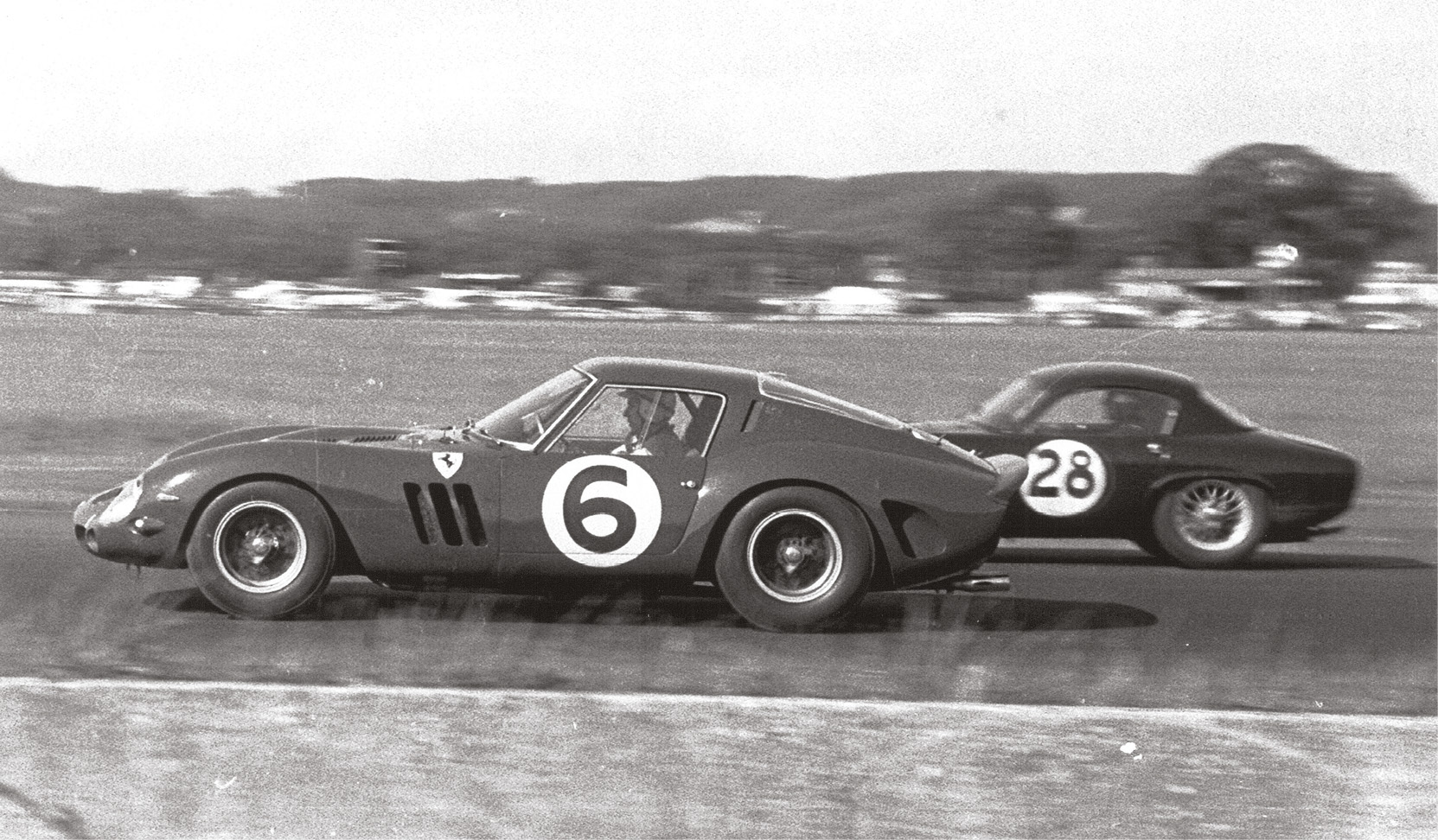 John Surtees (Ferrari 250 GTO) passes John Coundley (Lotus Elite) in the 1962 TT. Surtees might have won but for a tangle with Jim Clark