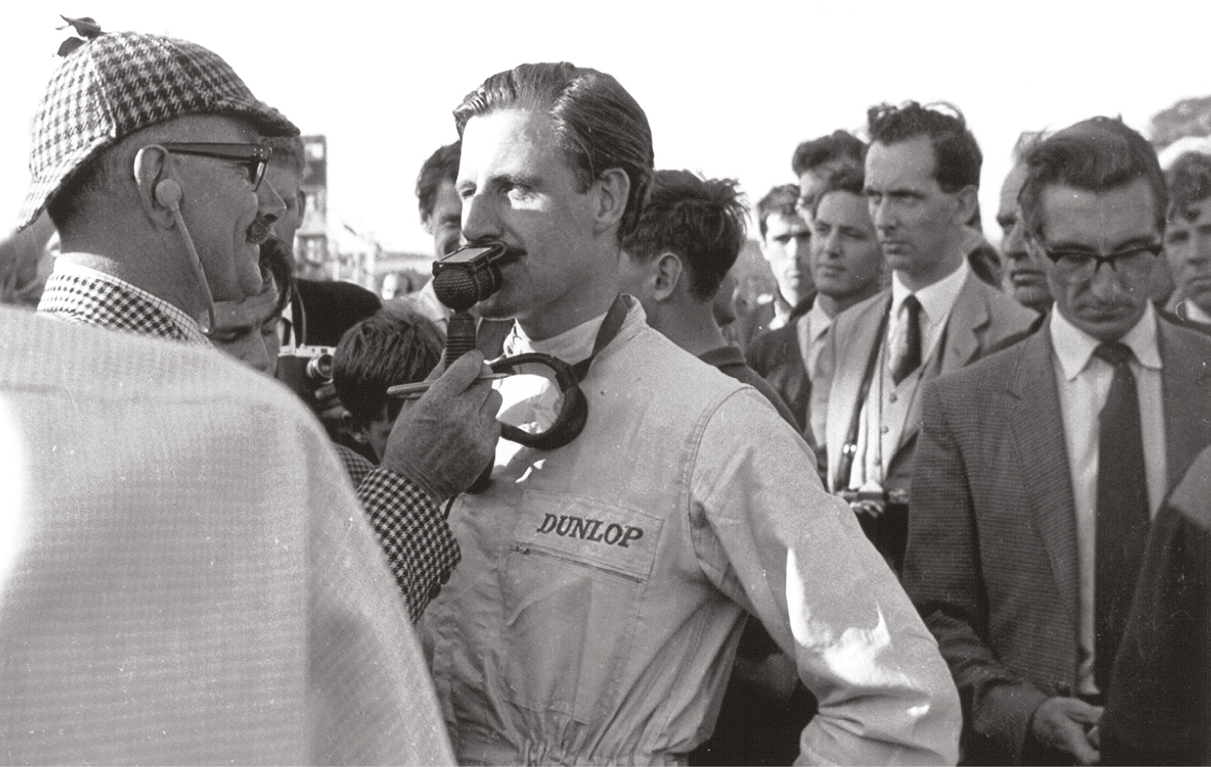 Graham Hill with commentator John Bolster