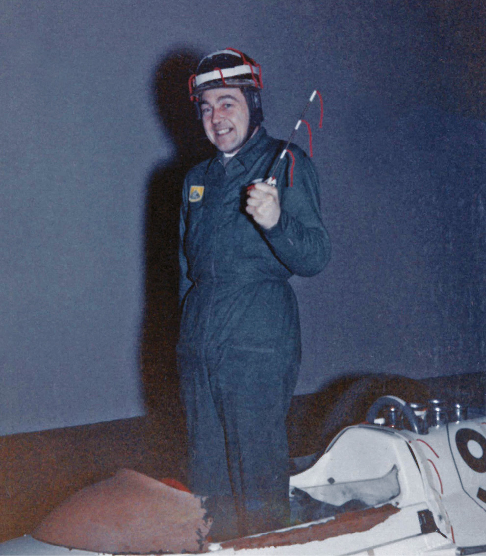 Lotus 29 screen test at MIRA; mechanic Jim Endruweit with wool-tufted helmet and wand used as a low-tech way to monitor airflow