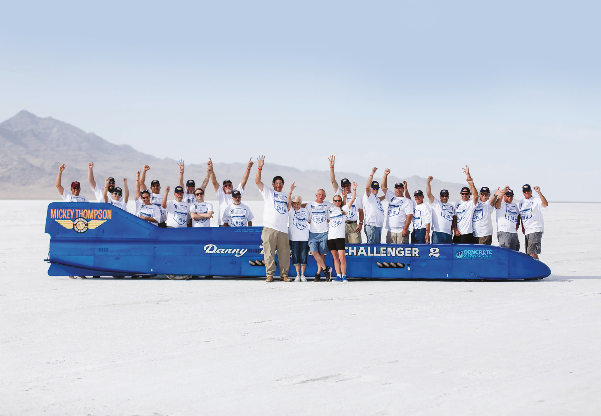 The volunteer-led team behind Challenger II celebrate, with Mickey Thompson's name still emblazoned on the car