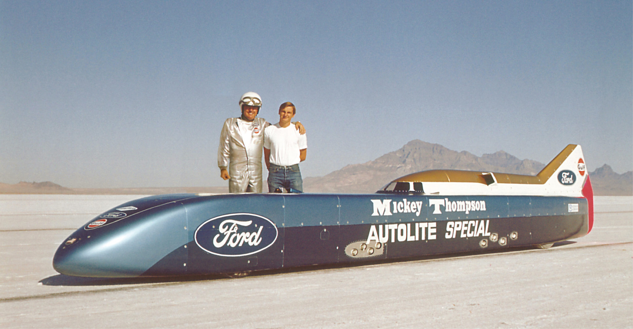 Mickey Thompson and his son Danny stand with Challenger II, then the Autolite Special, in 1968
