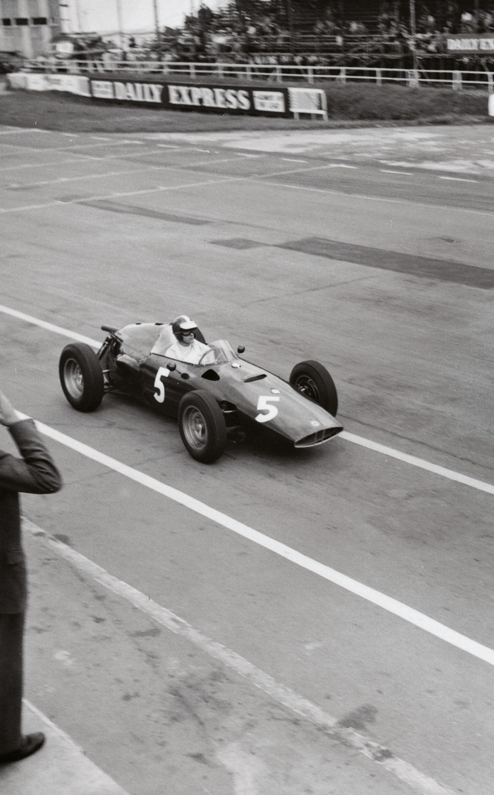 All shots below here are from the 1960 British GP meeting. Here, Dan Gurney enters the pits in his BRM P48