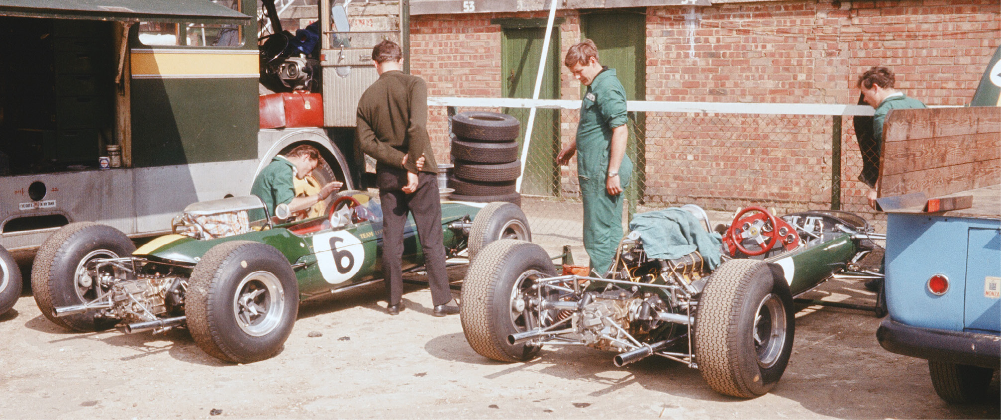 Lotus 33s at rest, Mike Spence's car to the left. Team-mate Jim Clark took his fourth British GP victory