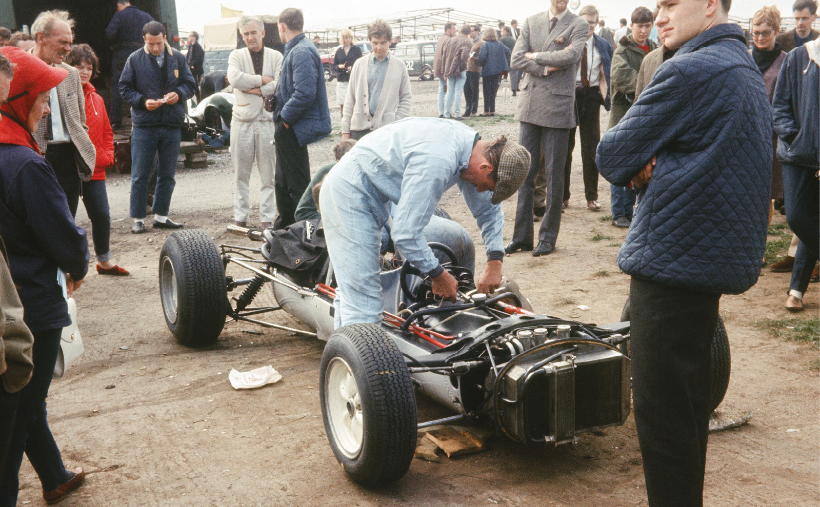 Graham Hill appears to be adjusting the steering column reach in John Coombs' Lotus 35-BRM, which he took to fourth place in the British Eagle Trophy F2 race at Brands Hatch on August 30. Jim Clark won in a Ron Harris-Team Lotus 35-Cosworth