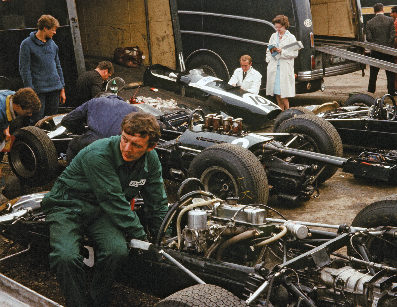 The Silverstone pits in more basic times: factory Cooper mechanics fettle the Climax-engined T77s of Bruce McLaren and Jochen Rindt