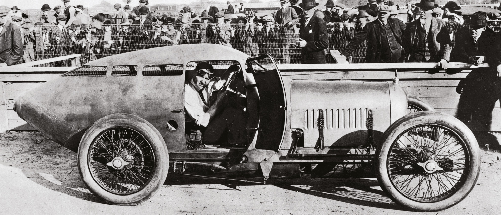 Oldfield at the wheel of the Golden Submarine during a promotional event at Daytona in 1922
