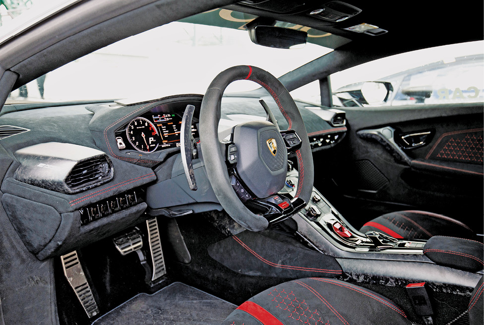 Performante interior is as you'd expect from a supercar, angled and bathed in Alcantara