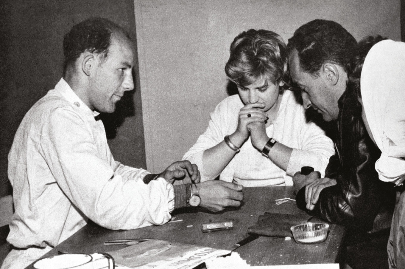 Le Mans 1959: Moss plays liar dice with Valerie Pirie and French businessman and racer François Picard (right) while awaiting his stint