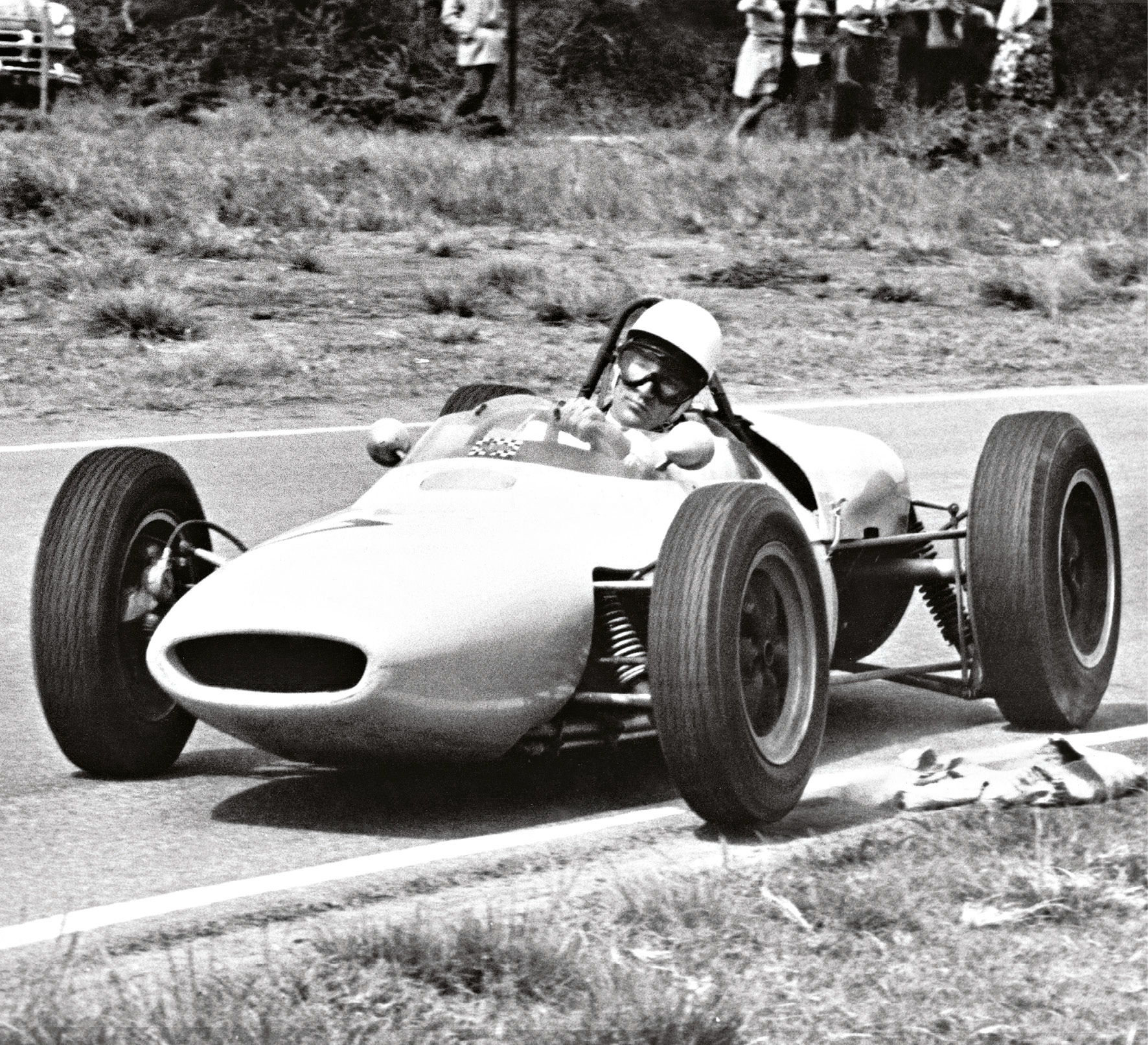 Moss on his way to second place in the 1961 South African GP at Prince George Circuit, East London. Beaten that day by Lotus's Jim Clark, it undoubtedly prompted another late-night debrief over a Chinese...