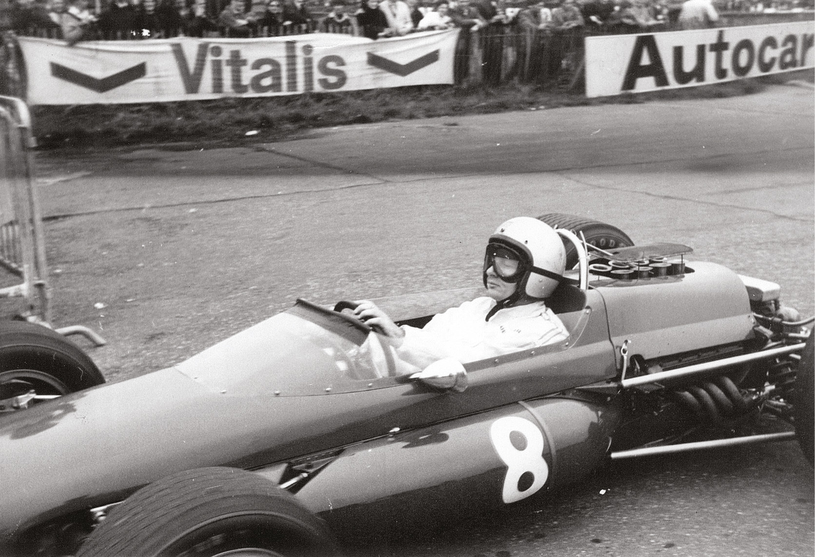 Bruce McLaren heads for the grid in his McLaren M4B; he was fifth while Mike Parkes' Ferrari won