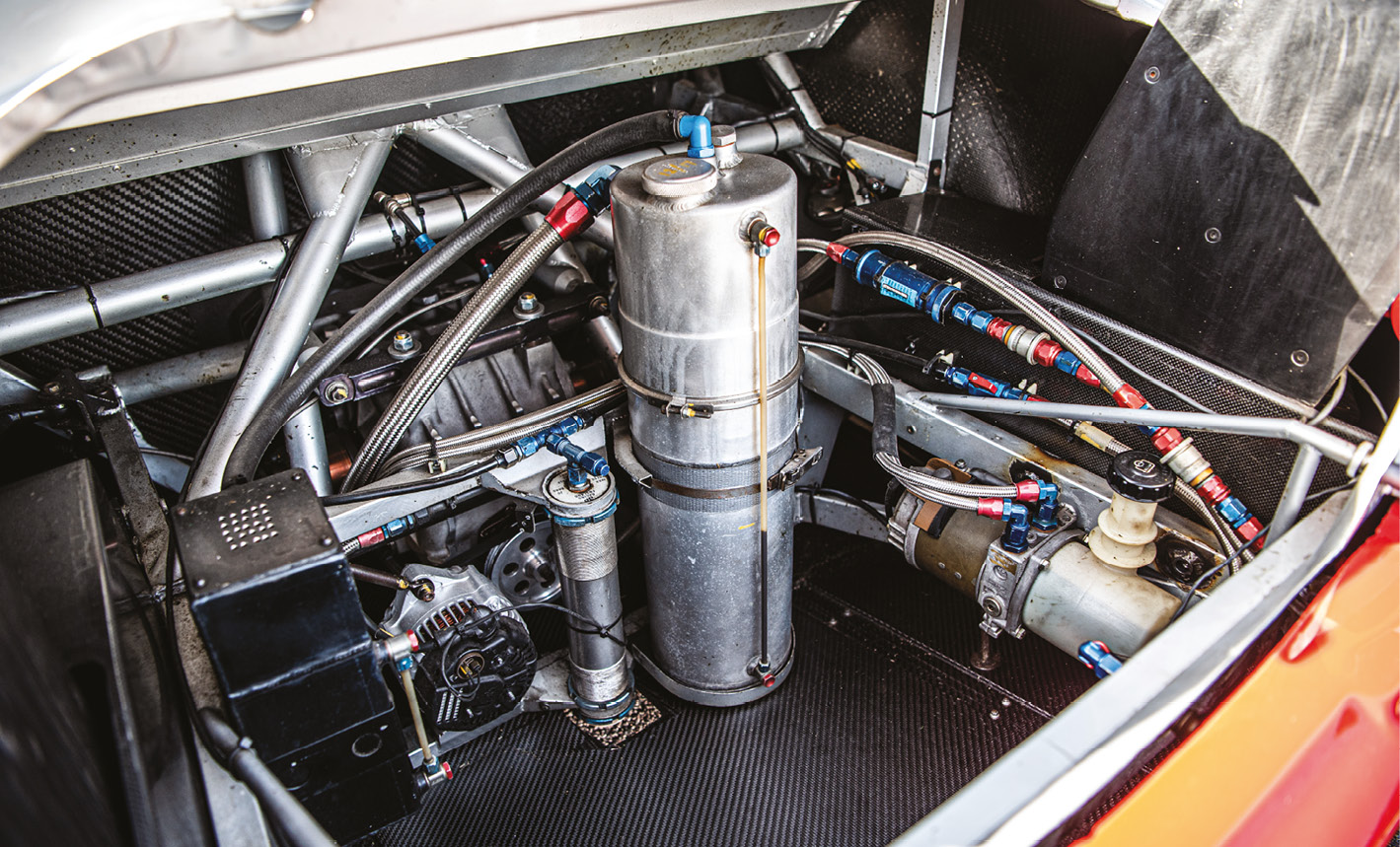 To aid weight, many ancillaries were moved to the boot area, where the gearbox and differential sit