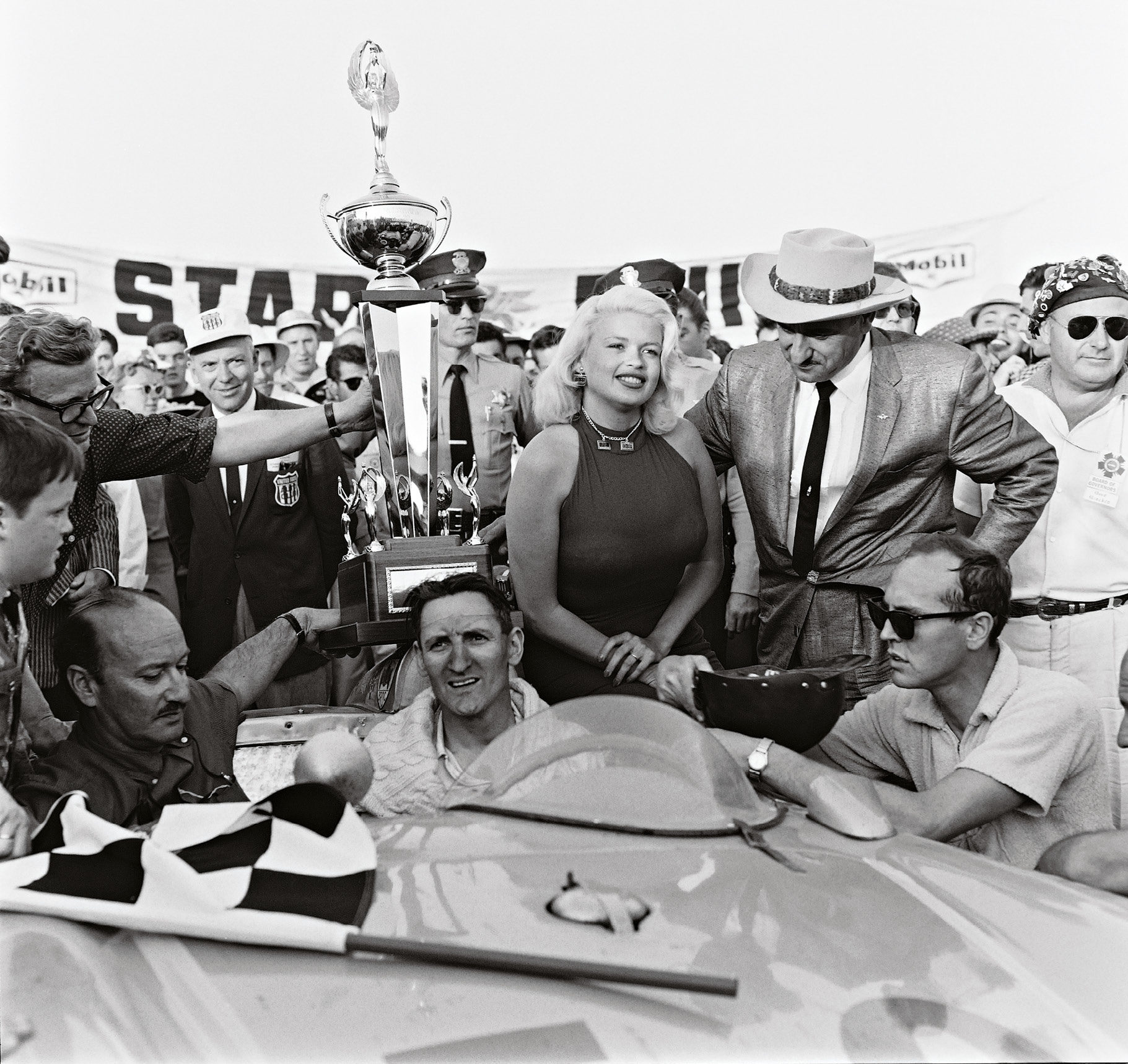The spoils of victory in a 1959 USAC race at Pomona. Miles got a celebratory kiss from actress Jayne Mansfield. Otto Zipper, the car's owner, sits in the passenger seat