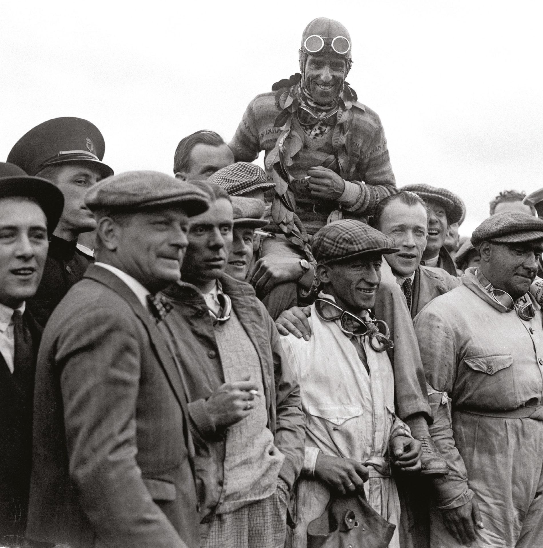 Nuvolari hoisted aloft by his Alfa team