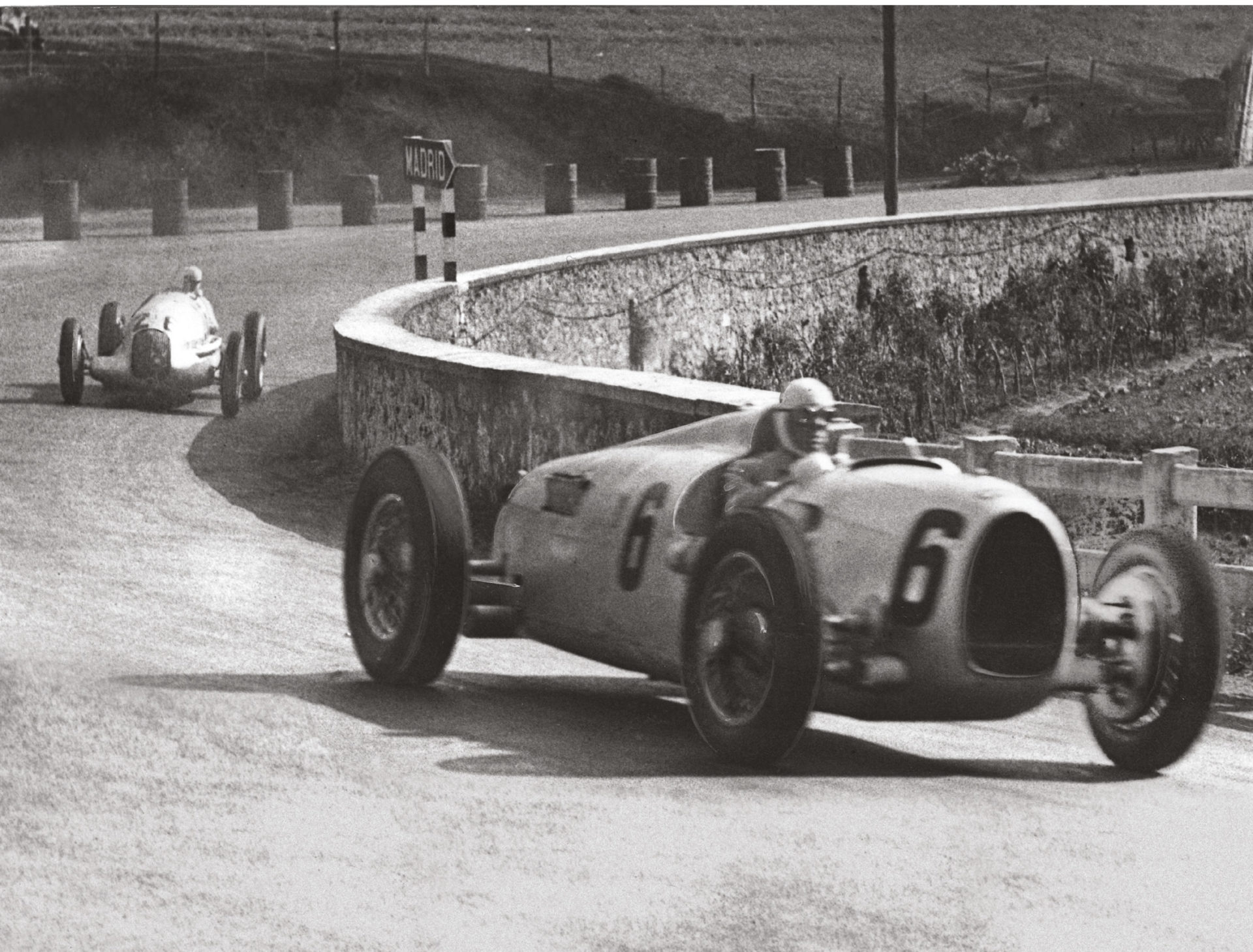 Italian Achille Varzi handles Auto Union's B-type in 1935. Mercedes' W25B is behind in the hands of Rudolf Caracciola