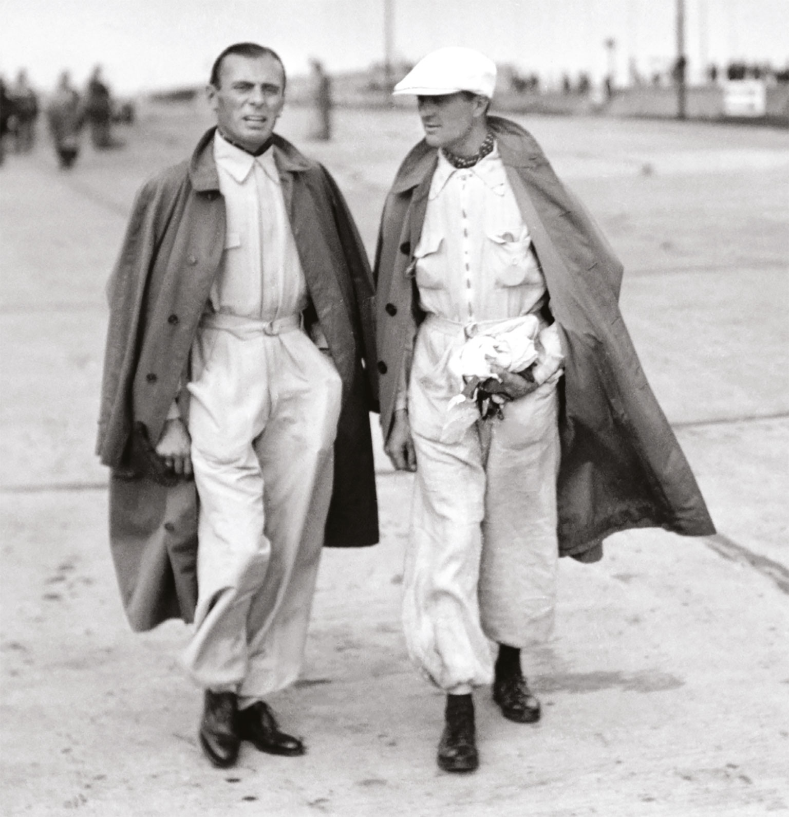 Auto Union's Varzi (left) chats with Mercedes racer Louis Chiron