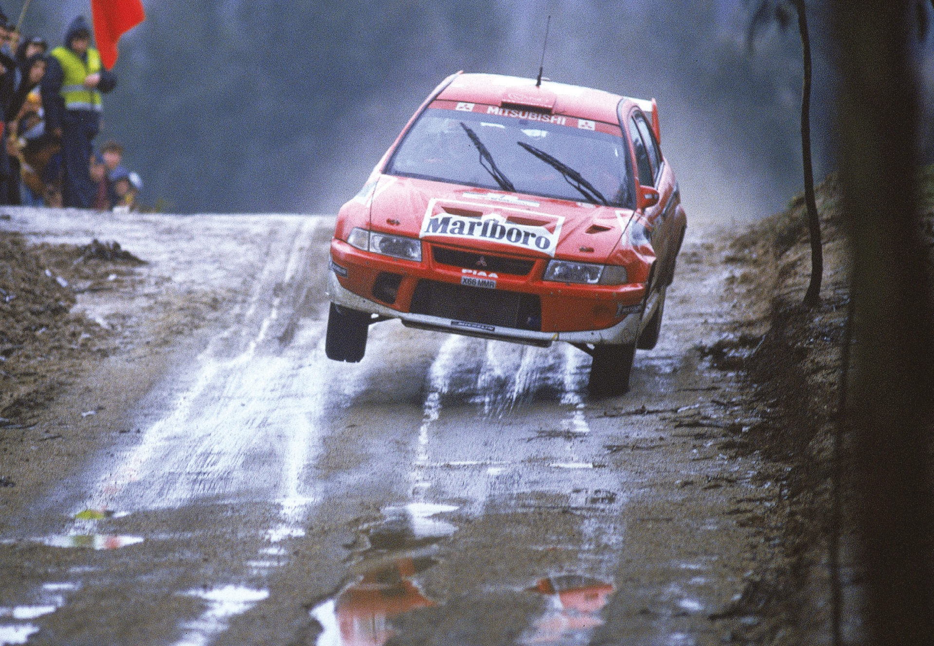 The Finn took the second of three wins in 2001 in his favoured Lancer Evo 6.5 at a rain-hit Portugal, beating long-time rival Carlos Sainz by a mere 8.6 seconds