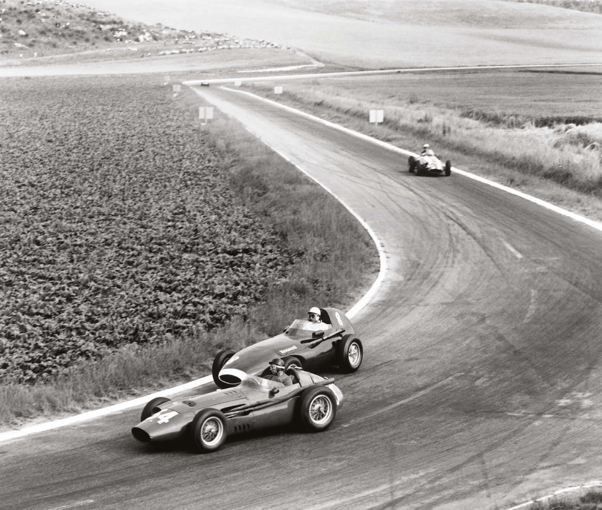 Juan Manuel Fangio's Maserati leads Stirling Moss in his Vanwall. While Italians dominated the early days, Vanwall won the first makes' crown in 1958