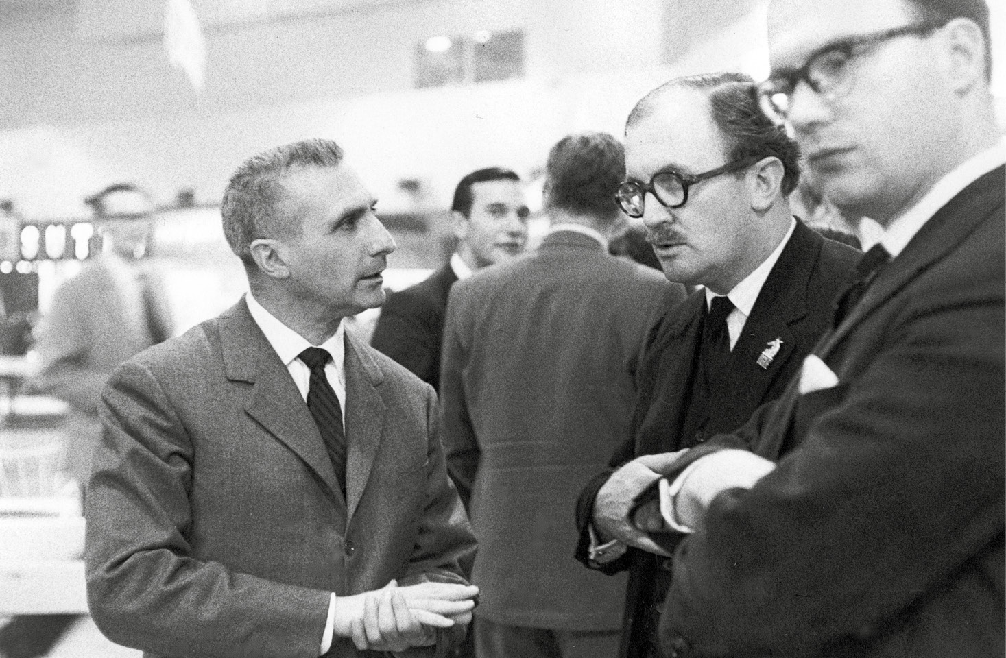 John Ogier (middle) chats to Dr Feyles Pinin Farina (left) at the1962 London Show
