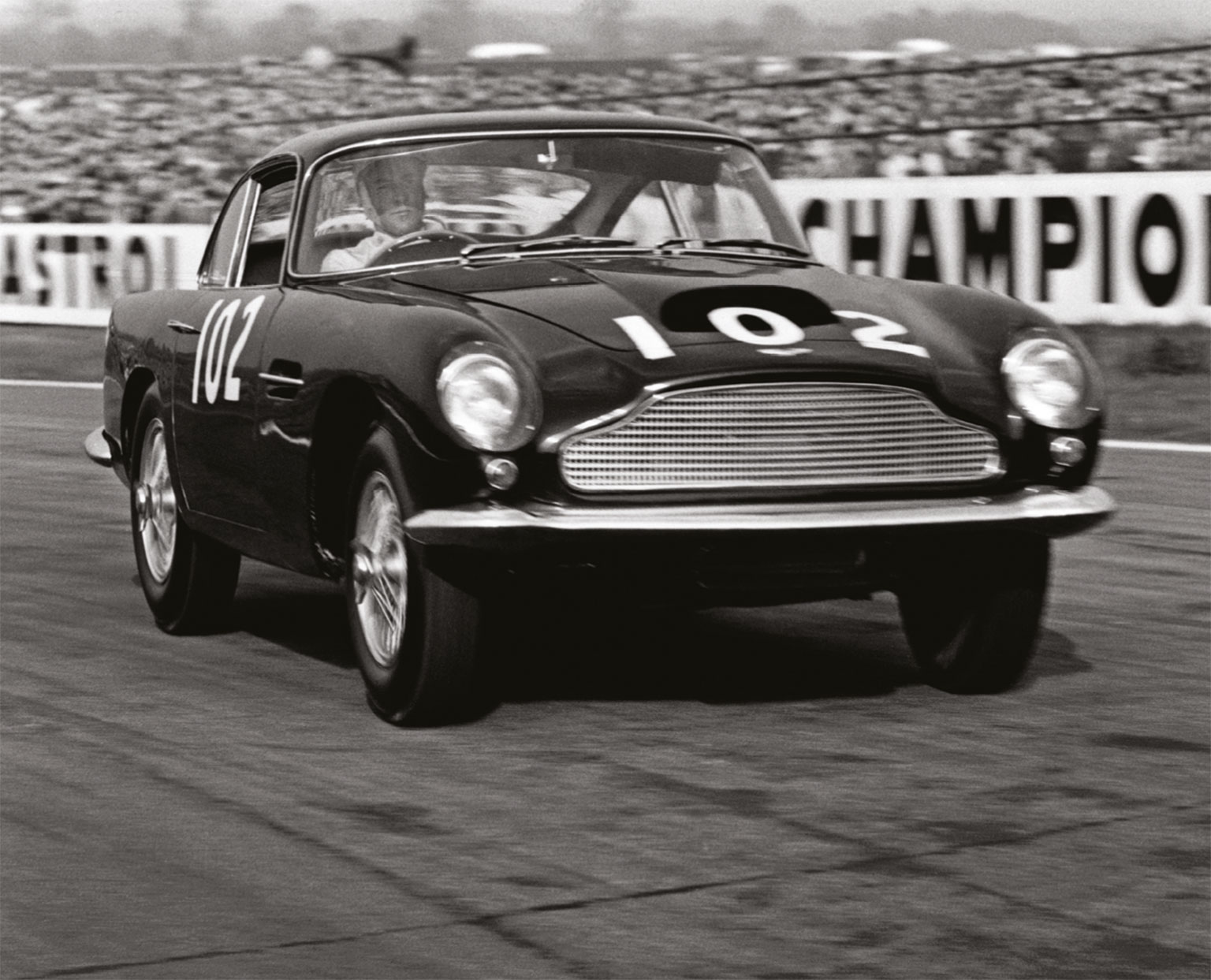 Stirling Moss at the wheel of a '60 DB4 GT at Goodwood