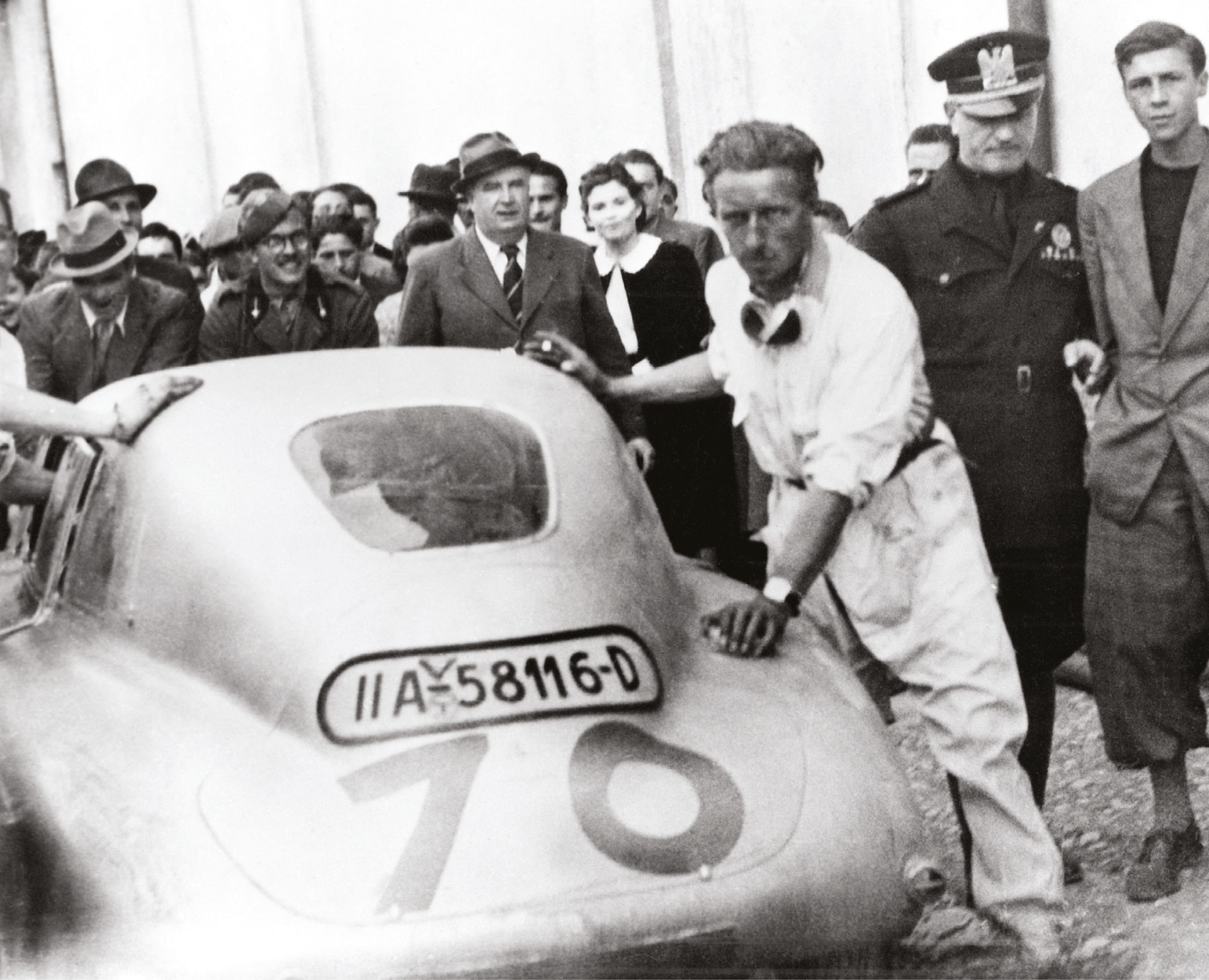 Prepare to win: Walter Bäumer, one of the winning drivers, leans on the Touring Coupé before the 1940 Mille Miglia