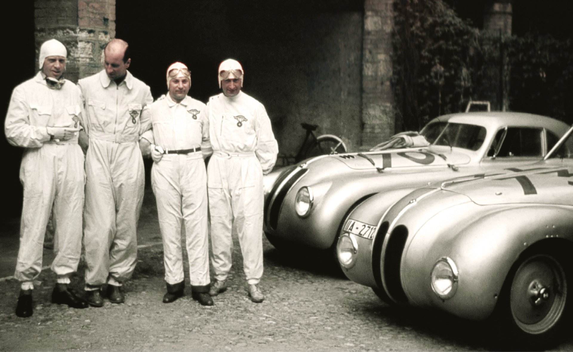 Drivers pose with both coupés in Brescia. Note the Kamm's heavier lines (front). Right: built in 28 days, the class-winning coupé averaged 84mph at Le Mans