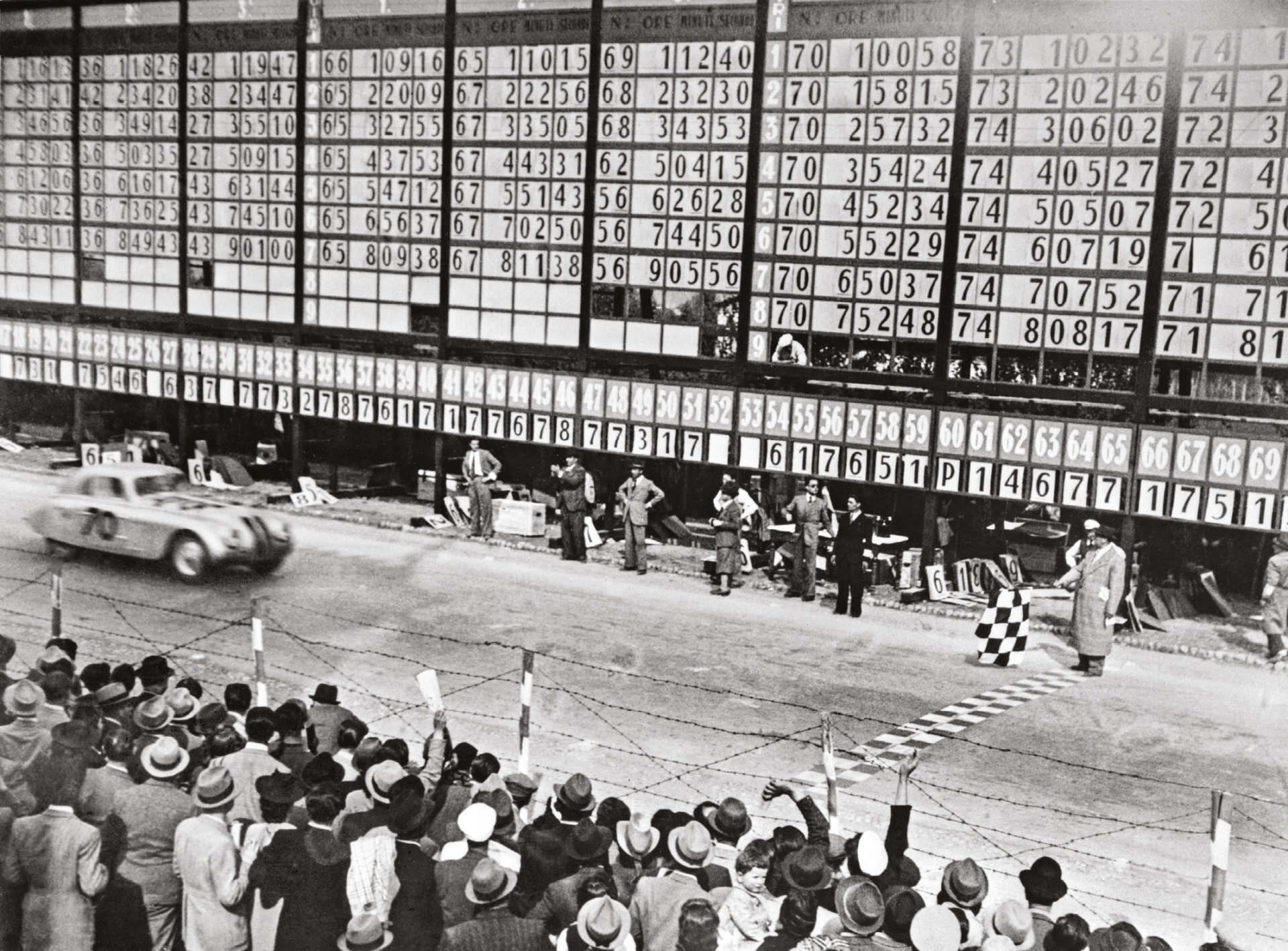 Moment of victory, with an unexcited flag waver. An Alfa win had been expected